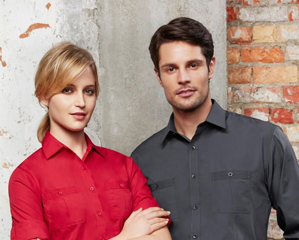 Man and woman wearing corporate uniforms